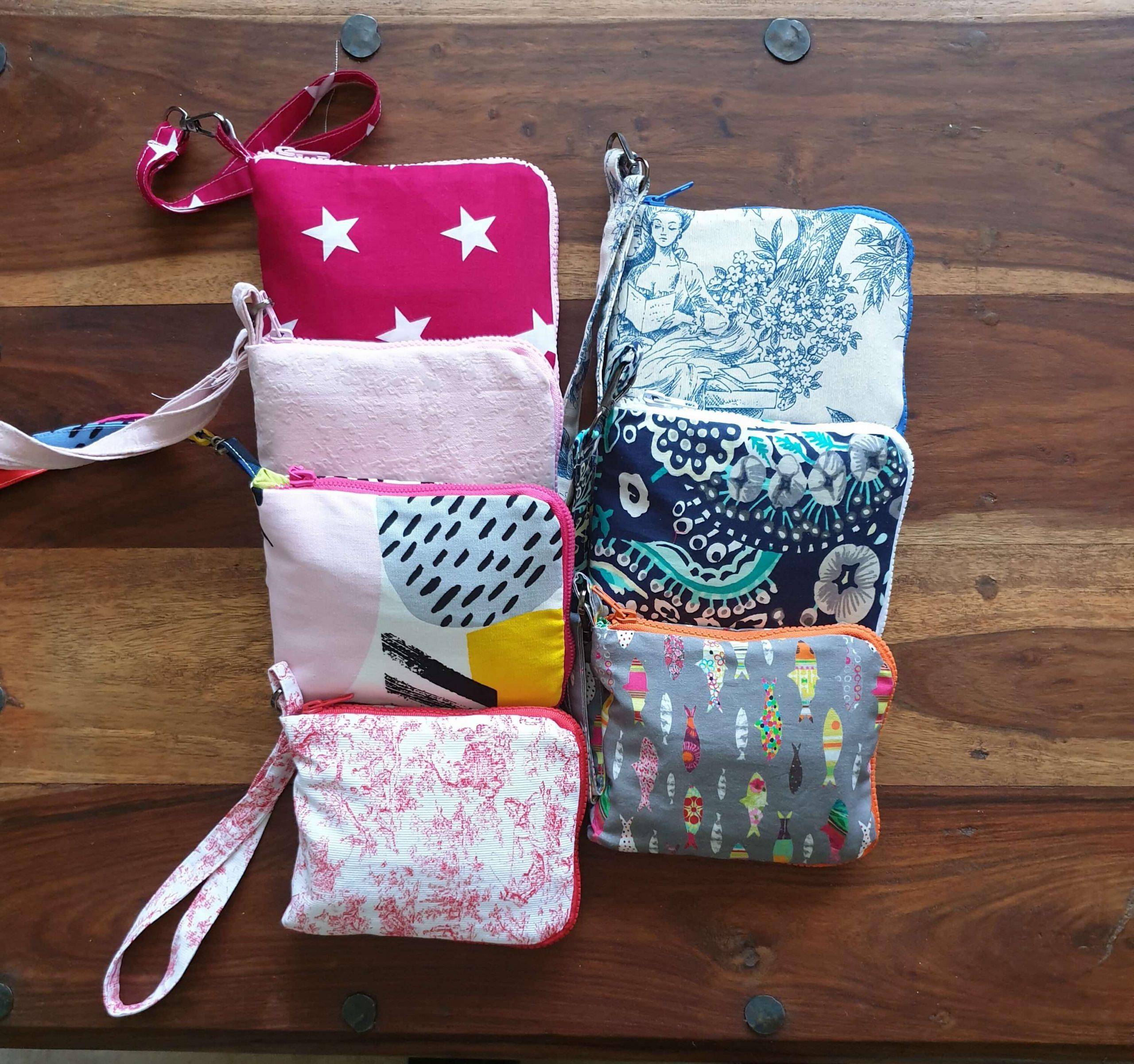 Diversos colores de bolsas de tela ecológicas reutilizables, lavables y funcionales